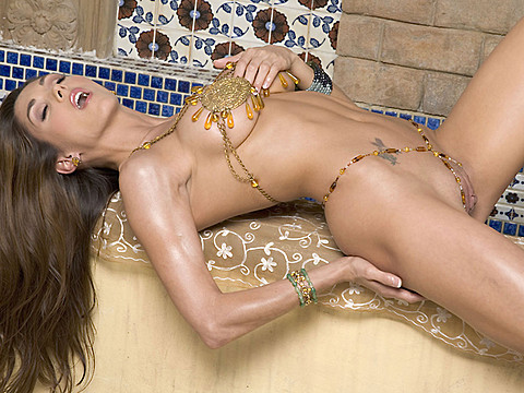 Penthouse Pet of the Year 2009 Taya Parker in gold filigree bikini posing outdoors