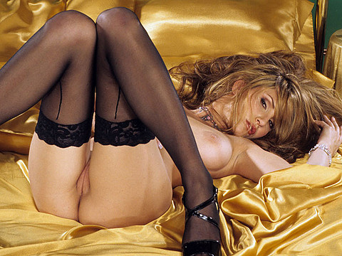 Jamie Lynn in black hosiery posing in bed